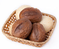 Fresh bread on a white background. Buns in a basket on a white background Stock Images