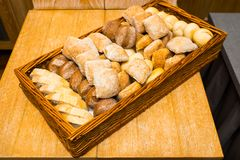 Fresh bread on a wicker basket. In the form of a tray stock photos