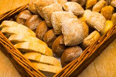 Fresh bread on a wicker basket. In the form of a tray royalty free stock image