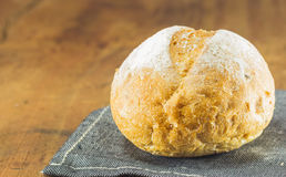 Fresh bread  on the wood background, warm toning, selective Stock Image