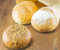 Fresh bread  on the wood background, warm toning, selective Royalty Free Stock Images