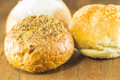 Fresh bread  on the wood background, warm toning, selective Royalty Free Stock Photos