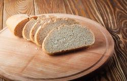 Fresh bread on wood desk. Royalty Free Stock Image