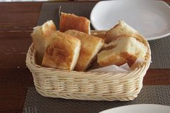 Fresh bread on the wood table. Fresh bread in a woven basket on the wood table in the restaurant Stock Photo