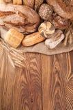 Fresh bread on wood Royalty Free Stock Photo