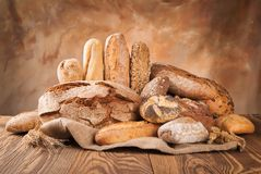 Fresh bread on wood Stock Photography