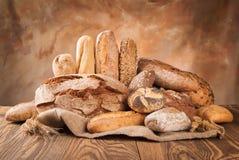 Fresh bread on wood Stock Photography