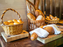 Fresh bread on wooden plate or basket Stock Photo