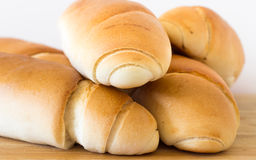Fresh bread on a wooden table, arranged, shallow depth of field. Royalty Free Stock Images