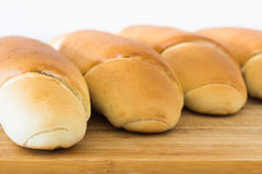 Fresh bread on a wooden table, arranged, shallow depth of field. Royalty Free Stock Photos