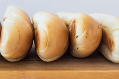 Fresh bread on a wooden table, arranged, shallow depth of field. Stock Image