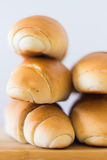 Fresh bread on a wooden table, arranged, shallow depth of field. Stock Images