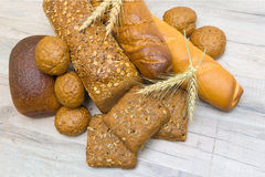 Fresh bread on the wooden table closeup Royalty Free Stock Photos