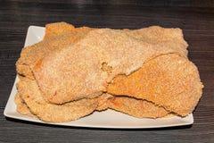 Fresh breaded Wiener schnitzel Stock Image