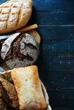 Fresh breads on boards Stock Images