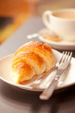 Fresh breakfast. Cup of fresh hot  coffe with croissant Stock Photos