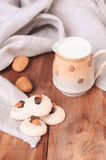 Fresh breakfast. Almond cookies with milk on wooden table, selective focus Royalty Free Stock Photography