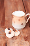 Fresh breakfast. Almond cookies with milk on wooden table, selective focus Royalty Free Stock Photos