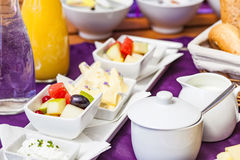 Fresh Breakfast or brunch with ham, eggs, bread, yogurt, fruits. And coffee on violet table and white dishware Royalty Free Stock Photo