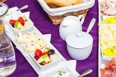 Fresh Breakfast or brunch with ham, eggs, bread, yogurt, fruits. And coffee on violet table and white dishware Royalty Free Stock Photography