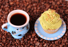 Fresh breakfast. Cup of coffee with homemade cup cake closeup, selective focus Stock Images