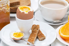 Fresh breakfast with eggs, toast and coffee with milk, close-up Royalty Free Stock Photo