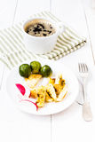 Fresh breakfast with fried eggs, brussels sprouts and radish on Stock Images