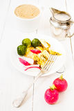 Fresh breakfast with fried eggs and radish on a plate on white w. Fresh breakfast with fried eggs, brussels sproutsand radish on a plate on white  background Stock Images