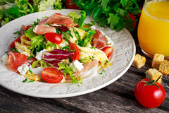 Fresh breakfast Omelette Salad with Parma Ham, feta cheese and vegetables Stock Photos