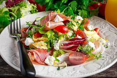 Fresh breakfast Omelette Salad with Parma Ham, feta cheese and vegetables. royalty free stock photography