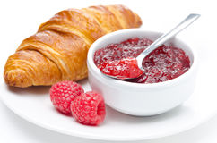 Fresh breakfast - raspberry jam and croissant on a plate Royalty Free Stock Photos