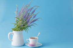Fresh breakfast scene. With flowers and macaroon Royalty Free Stock Photography