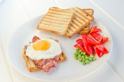 Fresh breakfest - ham, eggs, vegetable and toast. Homemade Royalty Free Stock Photo