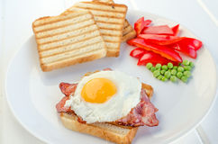 Fresh breakfest - ham, eggs, vegetable and toast Stock Photos
