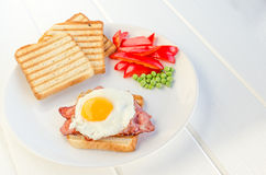 Fresh breakfest - ham, eggs, vegetable and toast Stock Image