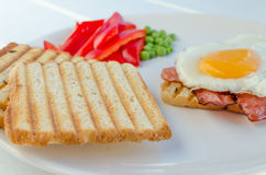 Fresh breakfest - ham, eggs, vegetable and toast Stock Images