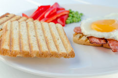 Fresh breakfest - ham, eggs, vegetable and toast Royalty Free Stock Images