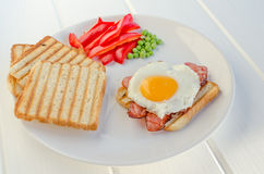 Fresh breakfest - ham, eggs, vegetable and toast Stock Photo