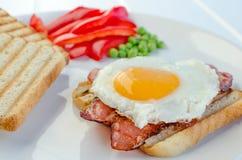 Fresh breakfest - ham, eggs, vegetable and toast Stock Images