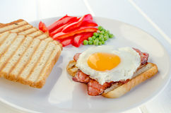 Fresh breakfest - ham, eggs, vegetable and toast. Homemade Royalty Free Stock Images