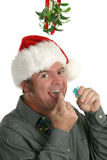 Fresh Breath Under Mistletoe Royalty Free Stock Photos