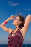 Fresh breeze. Portrait of young trendy woman outdoors enjoying the breeze royalty free stock photos