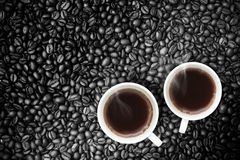 Fresh brewed Coffee With Coffeebeans Royalty Free Stock Photography