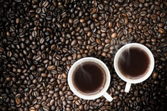 Fresh brewed Coffee With Coffeebeans Royalty Free Stock Image