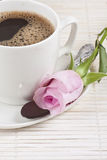 Fresh brewed coffee and a rose. Cup of fresh brewed coffee and rose Stock Photography