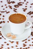 Fresh brewed cup of coffee on the plate with sugarcubes Royalty Free Stock Photos