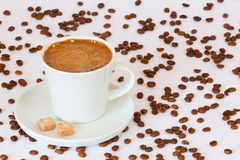 Fresh brewed cup of coffee on the plate with sugarcubes Royalty Free Stock Images