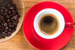 Fresh brewed hot espresso in red cup Royalty Free Stock Image