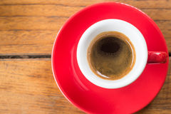 Fresh brewed hot espresso in red cup Royalty Free Stock Images