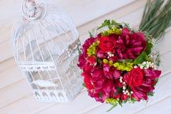 Fresh bridal bouquet. Red summer flowers. Stock Photos